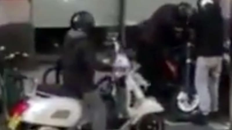 Thieves steal motorcycle in broad daylight as crowd looks on