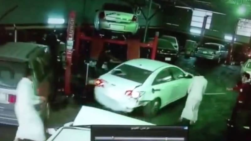 Alleged car thief tries to smash his way out of garage