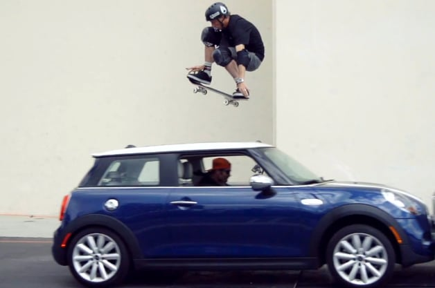 Tony Hawk jumps over a moving Mini Cooper
