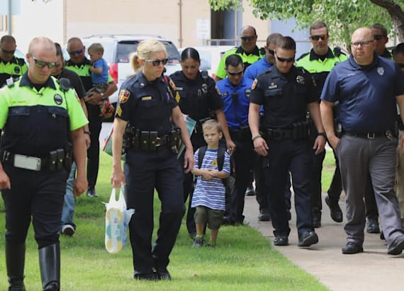 Officers escort fallen comrade's kids to school