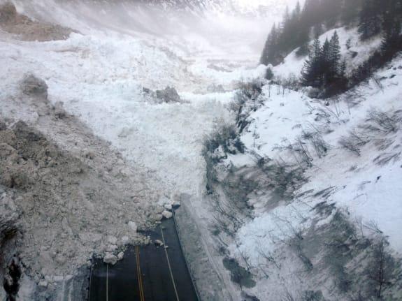 APTOPIX Avalanches Cut Off City