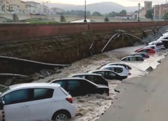 Cars left in ditch after sinkhole opens near bridge