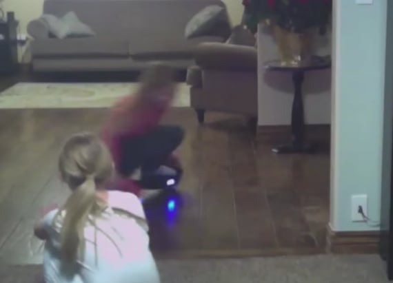 Little girl wipes out on spinning hoverboard