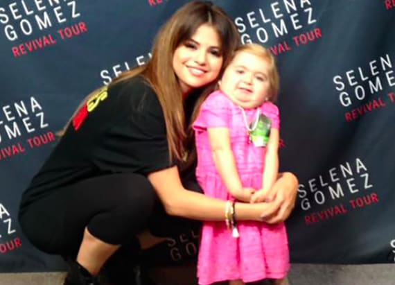 Selena dances with 7-year-old with rare disease