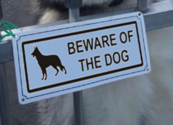 There is a 'beast' behind this Beware of Dog sign