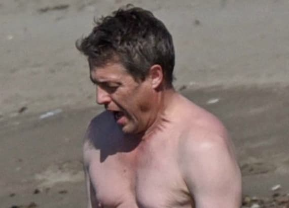 Hugh Grant shows off fuller figure