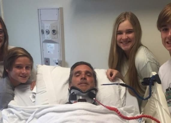 Dad left semi-paralyzed after being hit by wave