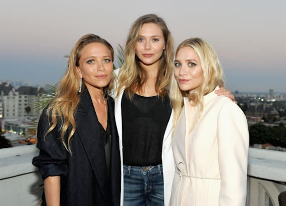 Olsen twins attend rare outing with sister