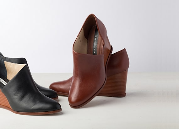 A designer bootie with a cutout twist