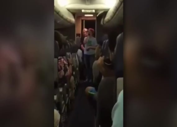 Woman entertains delayed flight with song