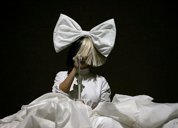 Sia accidentally shows her face