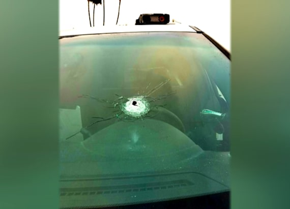 Badge saves cop from bullet during violent incident