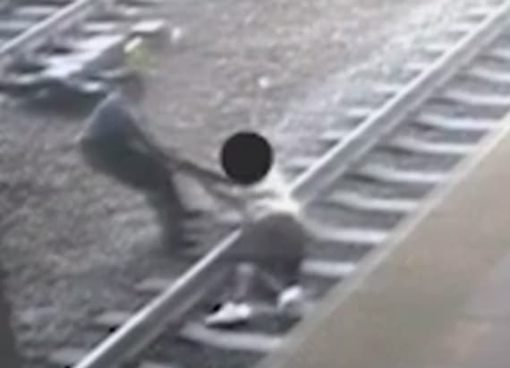 Hero officer who pulled man from path of train