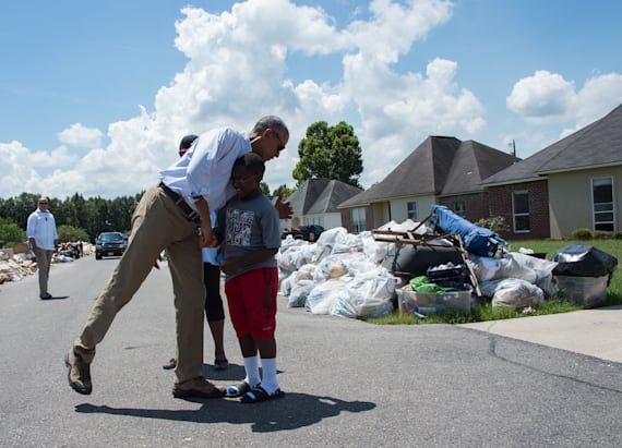 Obama visits La. flood survivors after backlash