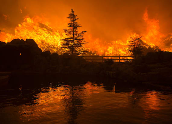 Officials make grisly find as wildfire rages