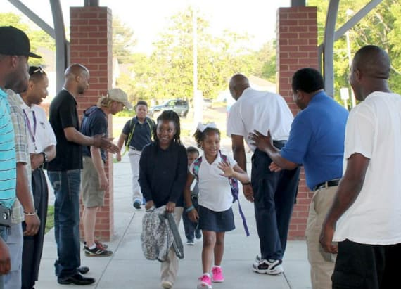 Hundreds of dads gather to cheer on students