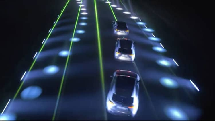 Will.i.am and Lexus make music on a runway with frickin' lasers
