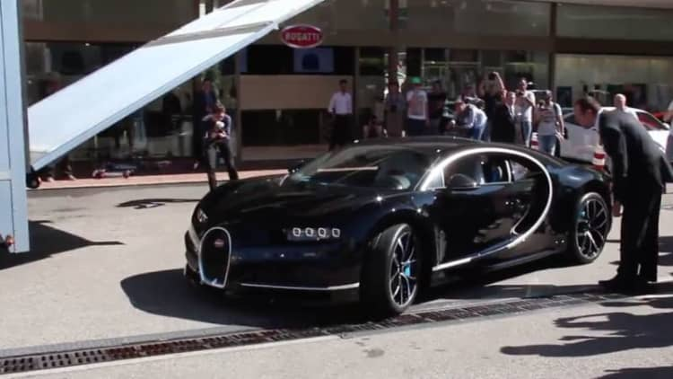 Watch a Bugatti Chiron arrive in style to Monaco dealership