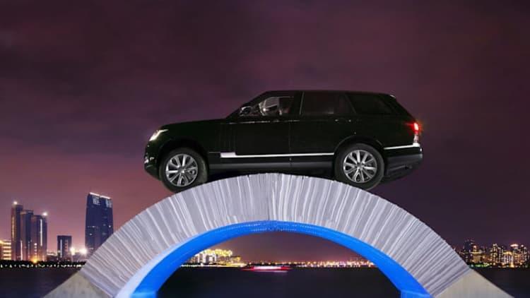 Range Rover drives across paper bridge to mark 45th birthday