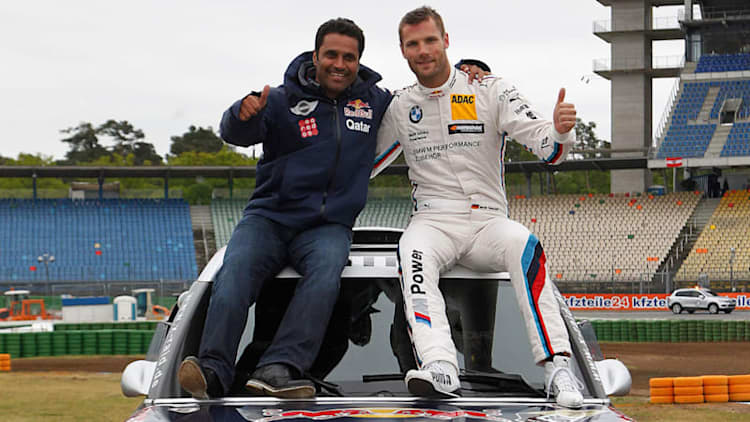 BMW's DTM champ swaps rides with Mini's Dakar winner
