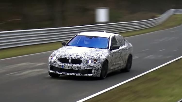 Watch the next BMW M5 slide its way around the Nurburgring