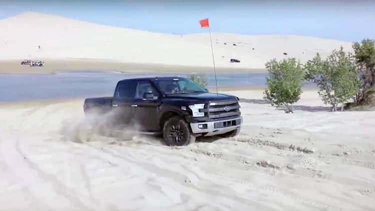 Watch the Ford F-150 Raptor play in the sand