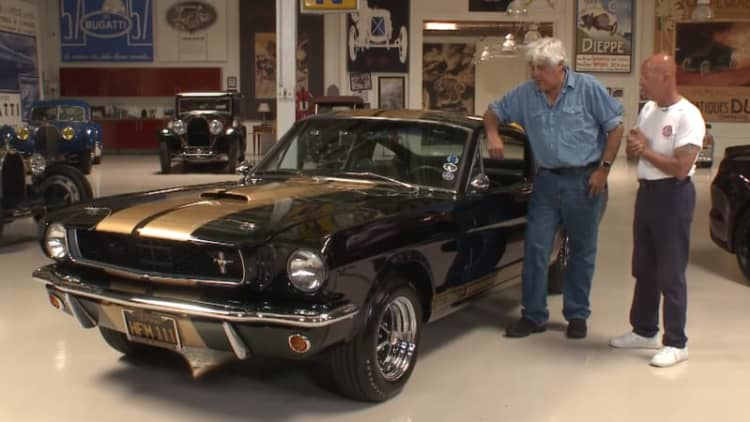 Jay Leno checks out a '66 Ford Shelby Mustang GT350-H