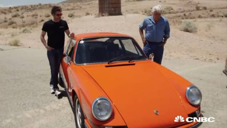 Jay Leno and McDreamy drive a classic 911 2.7 RS on a racetrack