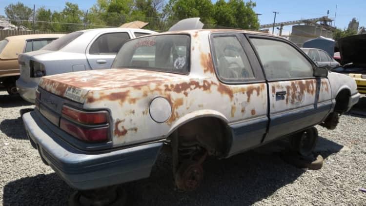 This junkyard '91 Grand Am is as hooptie as it gets