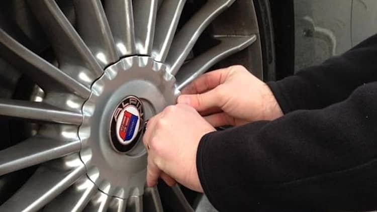 Check out the trick way you access the tire valve on this BMW Alpina B6
