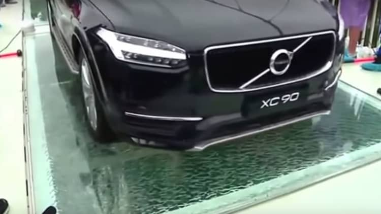 Volvo SUV drives across glass bridge to prove its safety