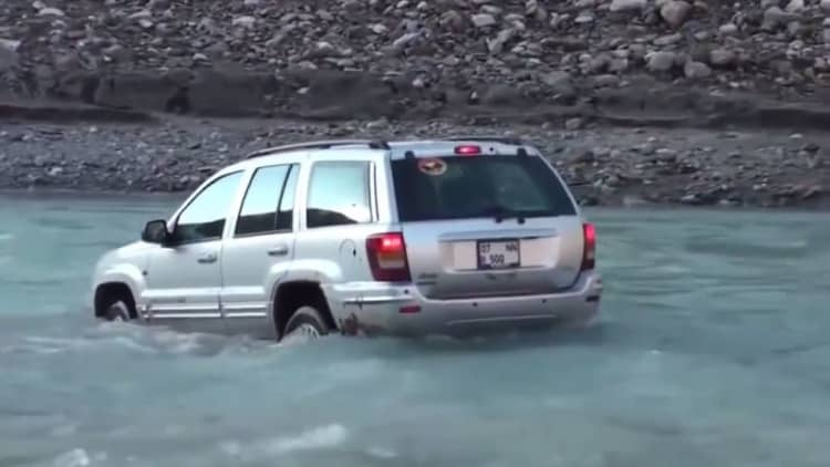 Jeep driver nearly gets washed away by fast moving river