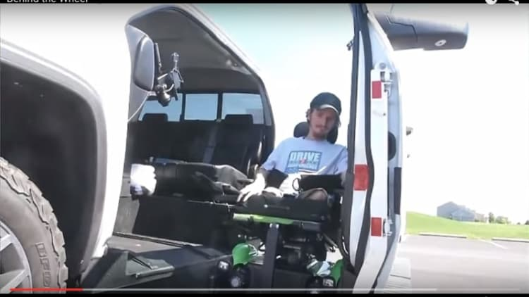 Disabled man realizes dream of driving with converted pickup truck