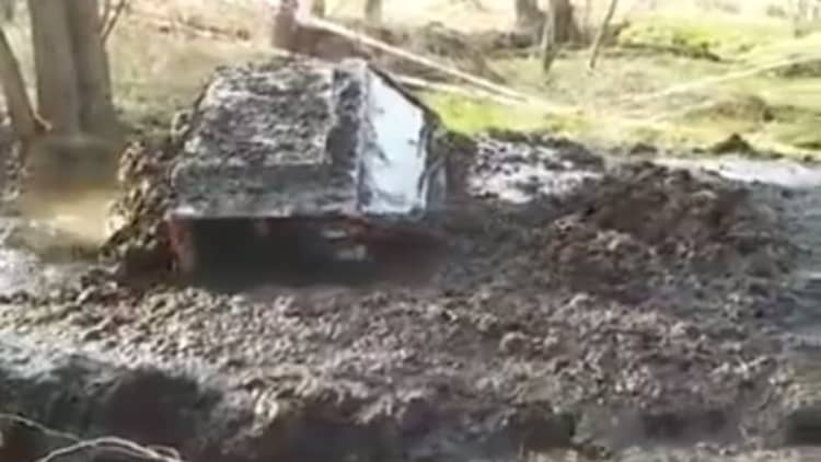 Off-roader plows through a deep bog like it was nothing