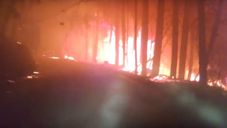 Harrowing drive through wildfire captured on video