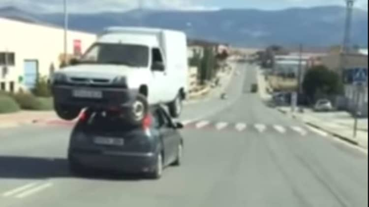 Man hauls huge truck on top of Ford Focus