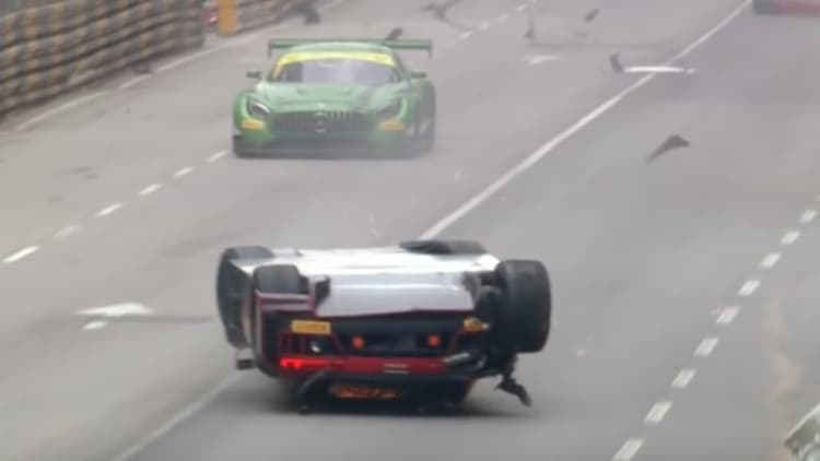 Crash sends race car driver sliding into first place