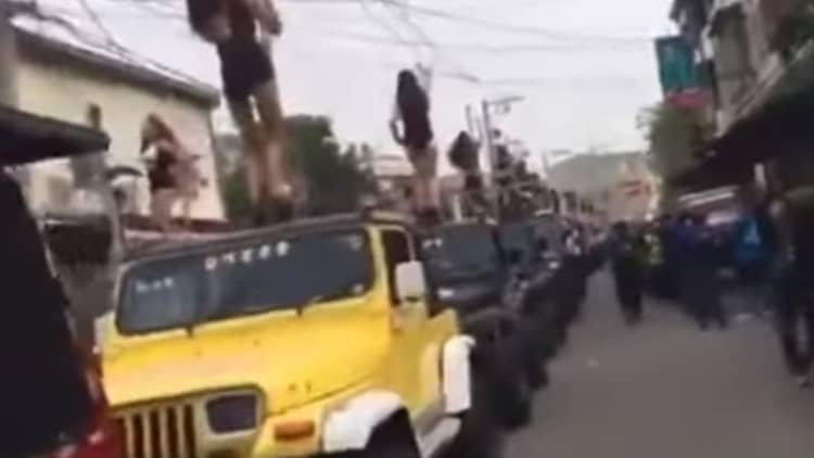 Politician's funeral procession features pole dancers