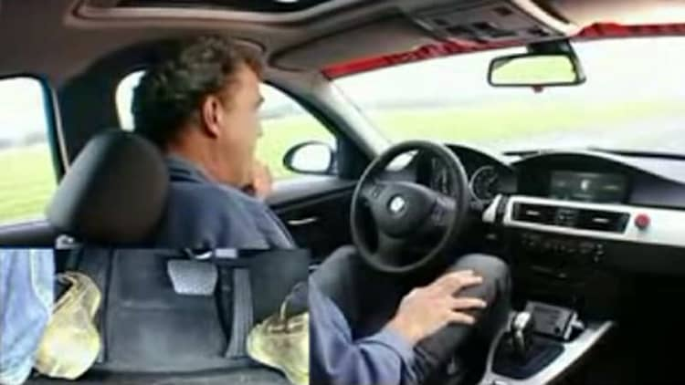 BMW 330i races around the Top Gear track... without a driver