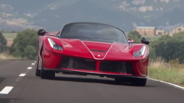 Ferrari F1 ace Sebastian Vettel shows the proper way to drive the LaFerrari Aperta