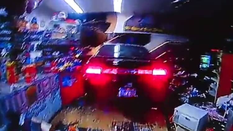 Man crashes car through store window, says he needs a beer