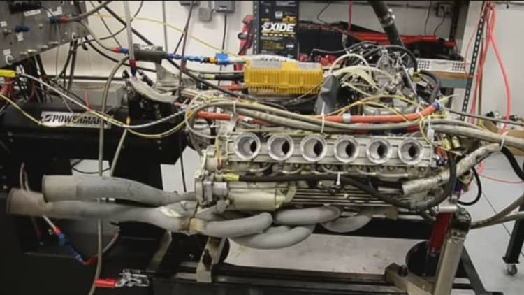Watch a vintage Ferrari racing engine shoot blue flames on a dyno