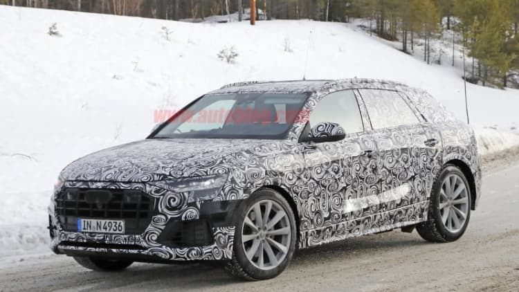 Upcoming Audi Q8 coupe-like crossover spied in the snow