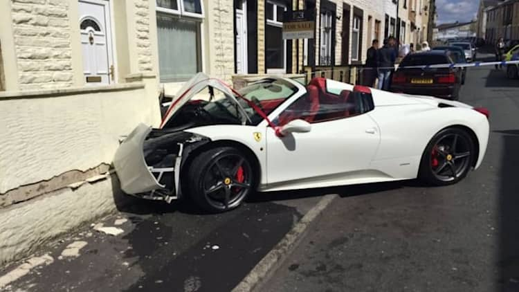 Newlyweds crash rented Ferrari into a house