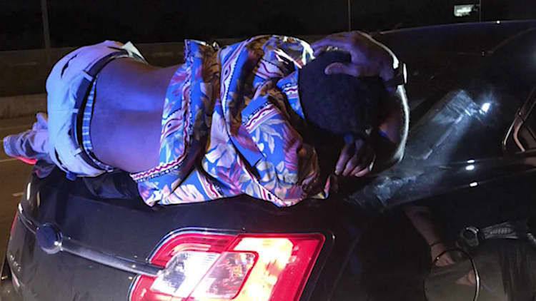 Couple unknowingly drive 14 miles with drunk guy passed out on trunk lid