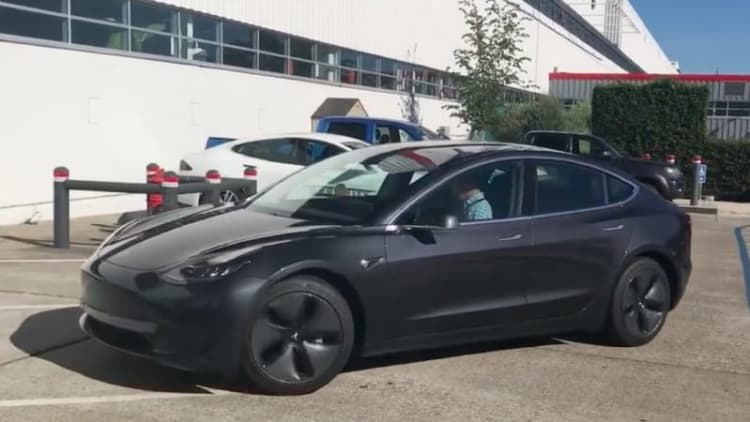 Get a closer look at the Tesla Model 3 as it drives away