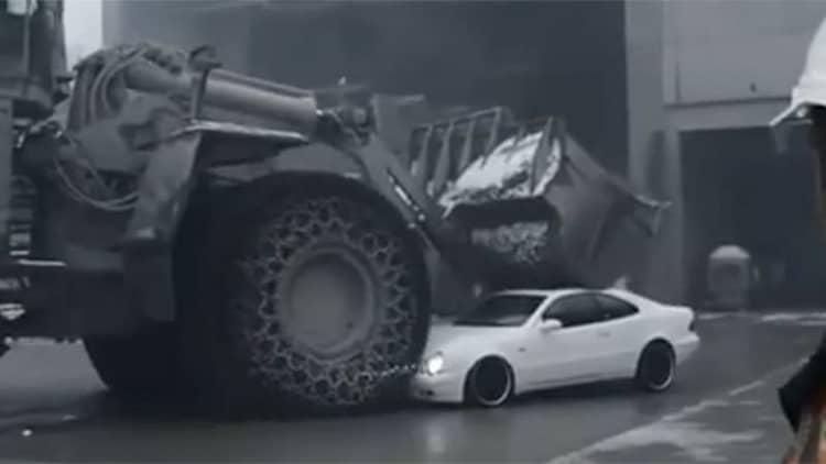 Watch this perfectly nice Mercedes get crushed by a front-end loader