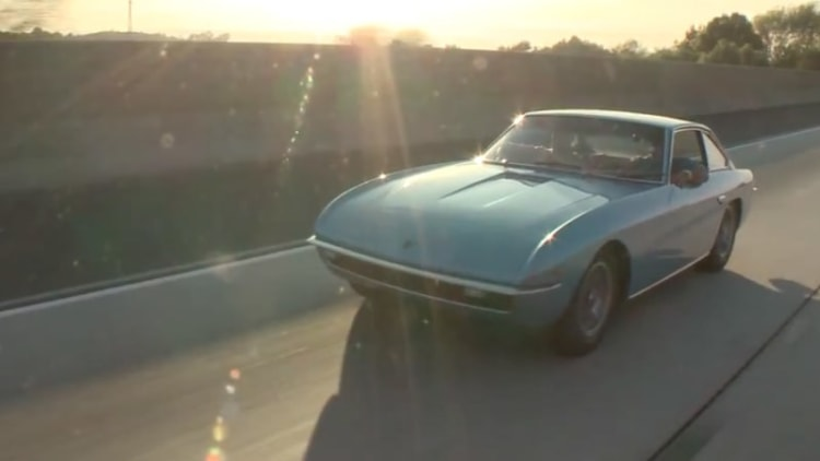 Leno hops behind the wheel of Adam Carolla's 1968 Lamborghini Islero