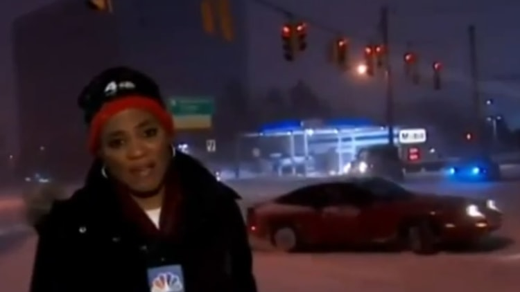 Nissan driver drifts on snowy roads during news broadcast