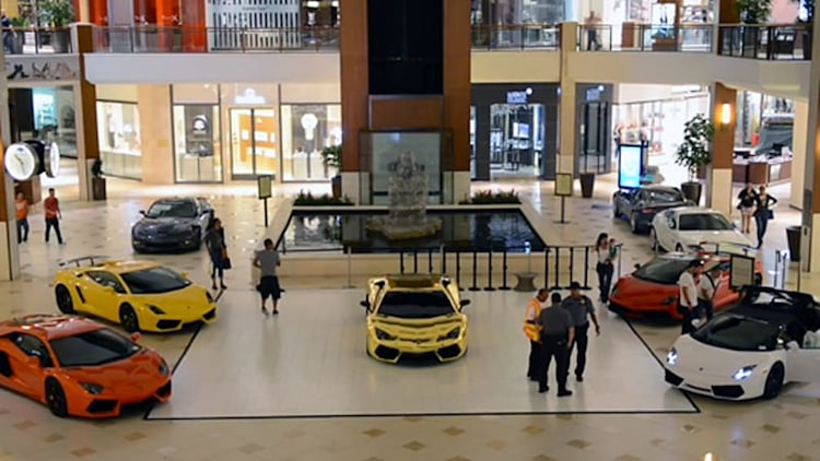 Watch a parade of five Lamborghinis make their way through a shopping mall